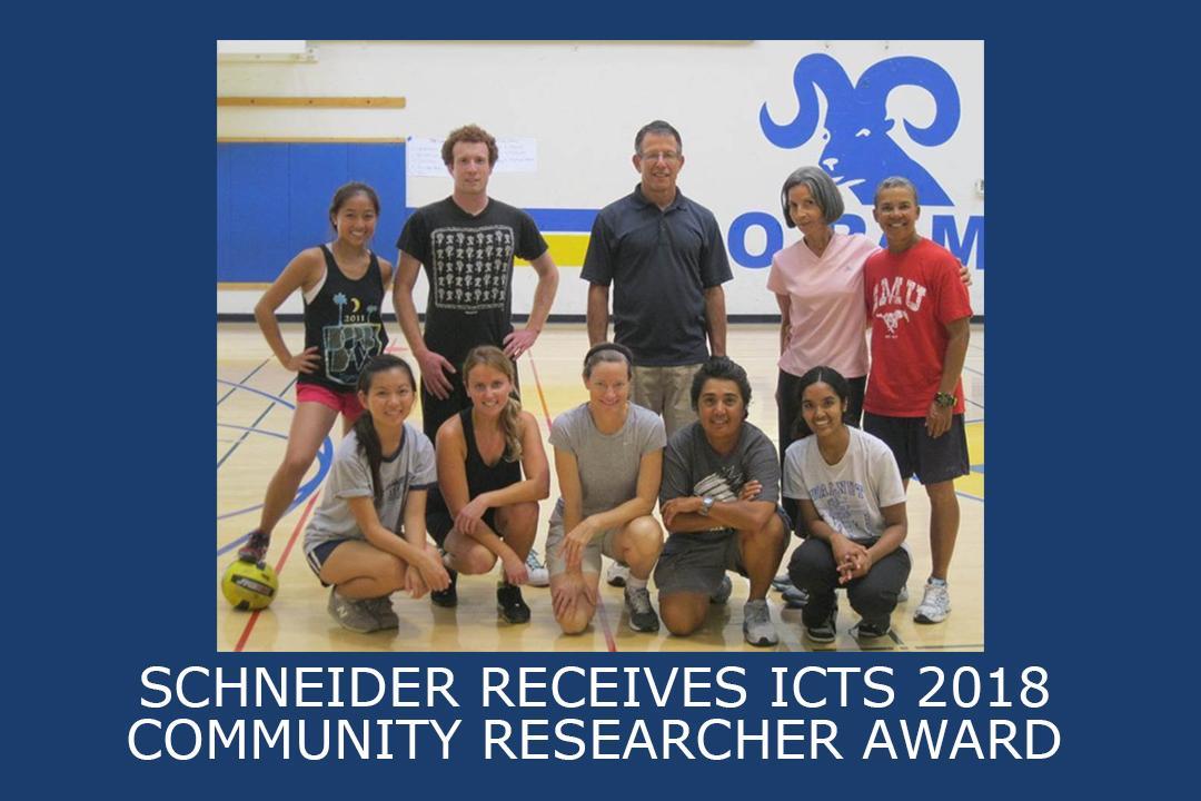 Schneider (center, bottom row) at one of her community-based study partner schools